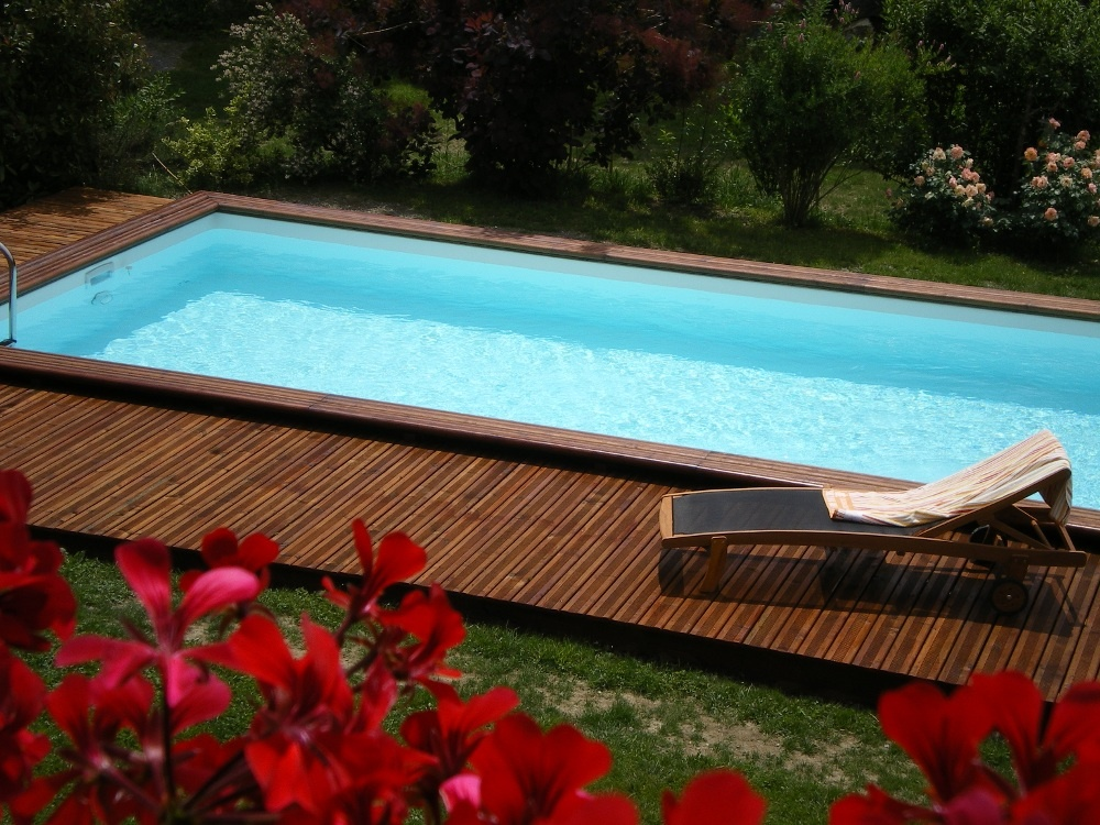 3 raisons de choisir une piscine en bois for Piscine enterrable